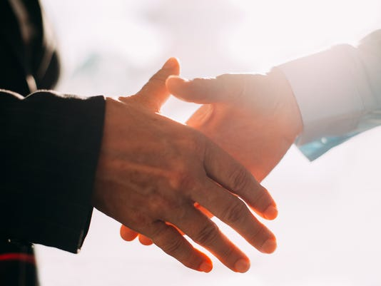 Close-up of business people hands shaking