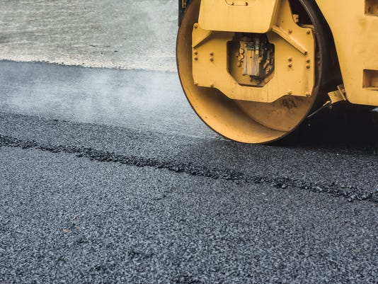 Road Roller While Working To crush the asphalt to condense.