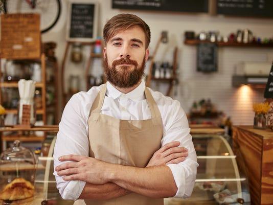 Portrait of confident cafe owner