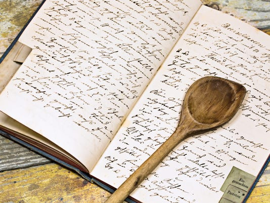Recipe book with wooden spoon