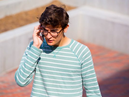 Teen Talking on Cell Phone Angry Confused