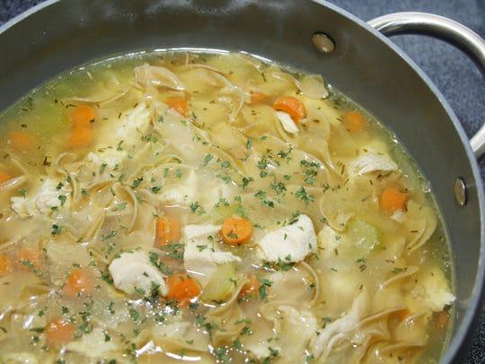 A hearty pot of chicken noodle dumpling soup helps