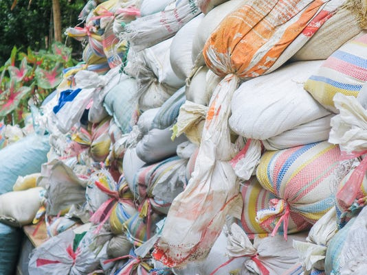 Sandbags pile for flood defense