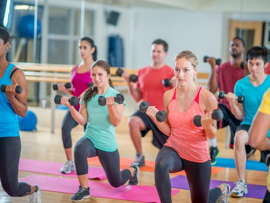 Young Adults in a Fitness Class