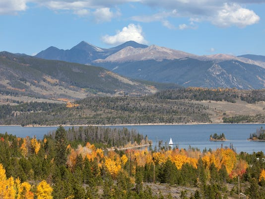 Sailboat on Lake Dillion with autumn Rocky Mountains