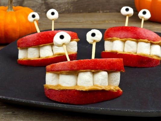 Halloween apple, marshmallow, peanut butter monster teeth snack