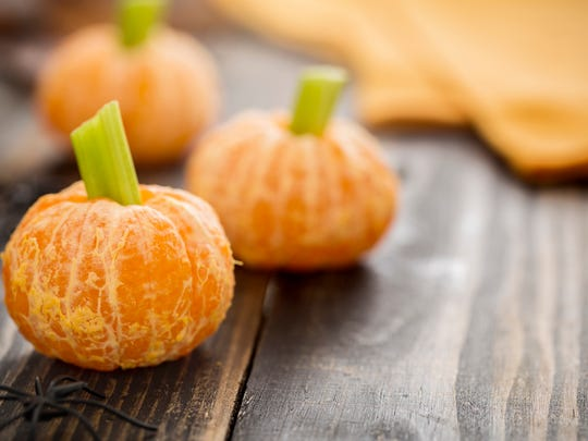 Clementines make great jack o' lanterns with the addition of a celery stick. Add some plastic spiders and you've got a creepy treat.