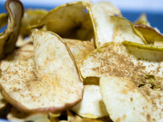 Baked apple chips are a healthy snack that can be enjoyed