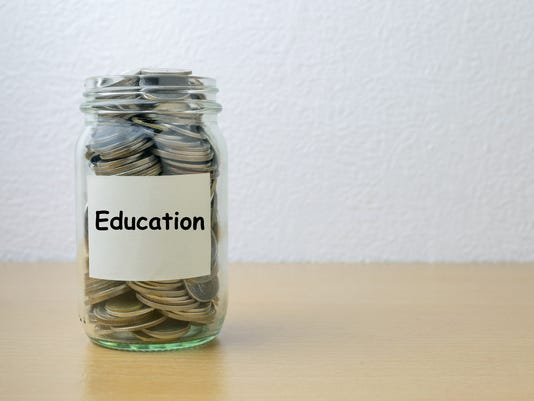 Money saving for Education in the glass bottle