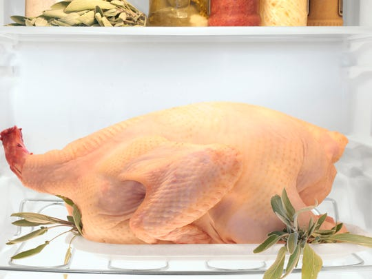 The USDA recommends thawing a frozen turkey in the refrigerator over several days.