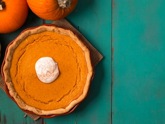 Refrigerate pumpkin pie to prevent further cracking. Or cover with whipped cream and dust with cinnmon.