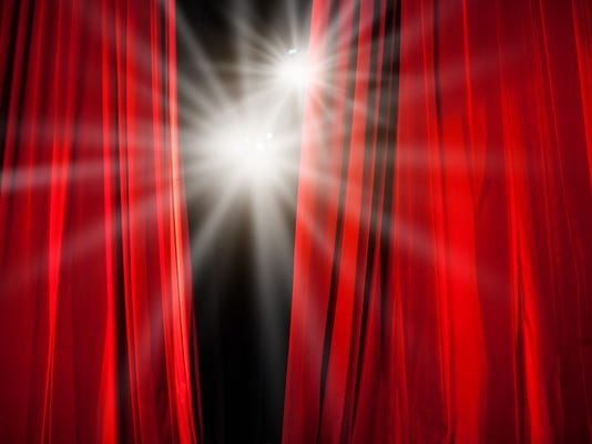 Red Curtain Opening with Stage Lights Shining Through