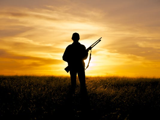 Woman Hunter and Rifle in Sunset