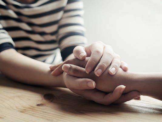Ask-Amy-Hand-Holding-Sad