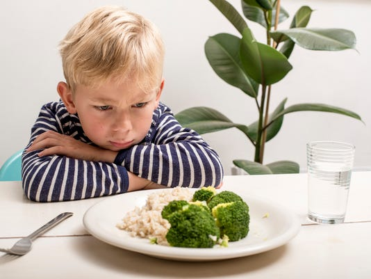Boy does not want to eat his veggies