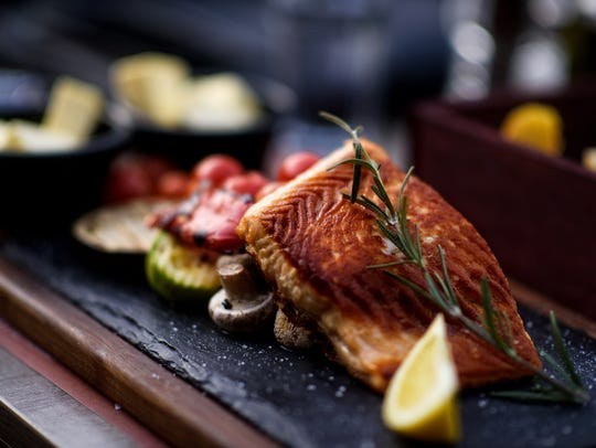This grilled salmon served with roasted vegetables