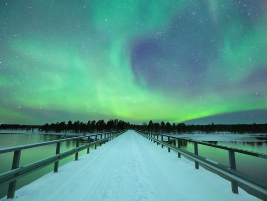 Aurora borealis over a bridge in winter, Finnish Lapland