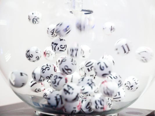 Lottery balls moving in glass sphere