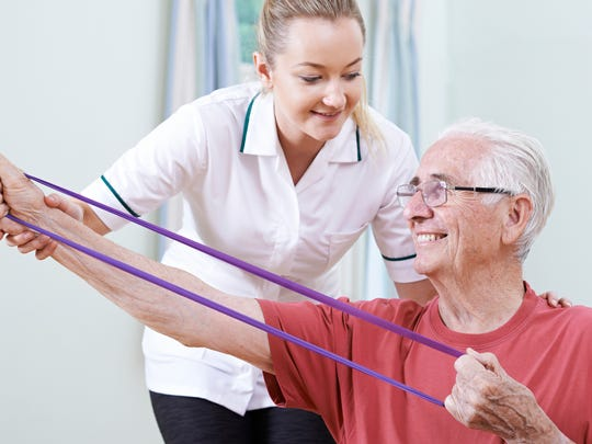 Helping people rebuild muscle and exercise is one aspect of an occupational therapy assistant's job.