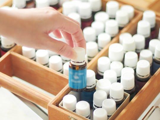 Woman choosing essential oil in Japan