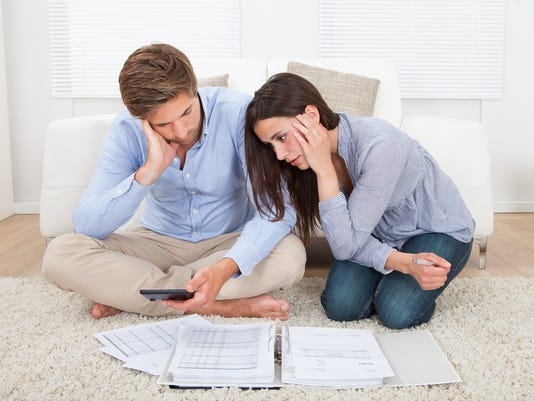 Couple In Financial Trouble At Home