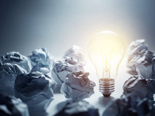 Light Bulb with crumpled paper ball.Business ideas