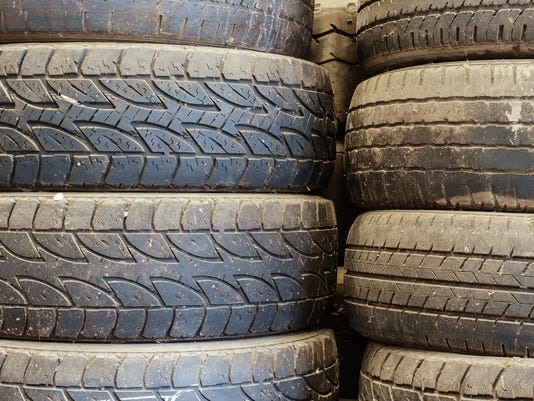 Old used car tires stacked up in the storage area