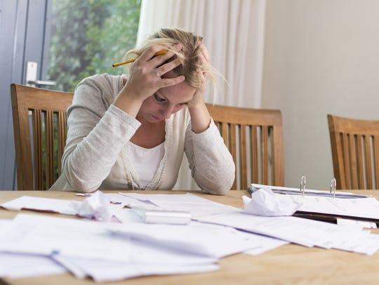 Woman worried about financial problems.
