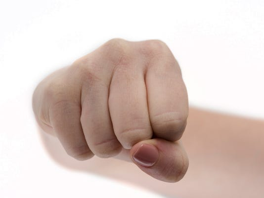 Fist. Girl fists clenched in anger. Woman's hands with fist gesture front side Isolated on white background. Hand gesture. Woman clenched fist ready to punch close-up. Self defense. Martial art boxing