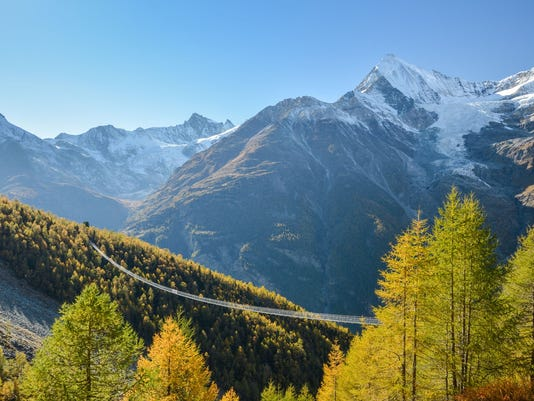 Charles Kuonen suspension bridge in Swiss Alps. With 494 metres, it is the longest suspension bridge in the world