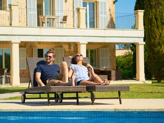 couple relaxing in garden of private country estate