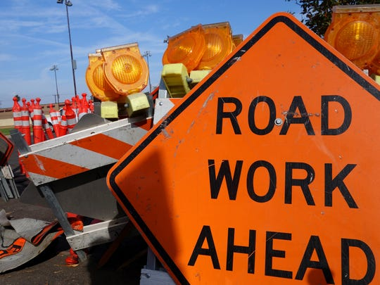 traffic barricades and road work ahead sign