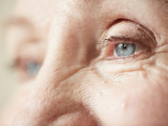 Wrinkles on an elderly woman's face.