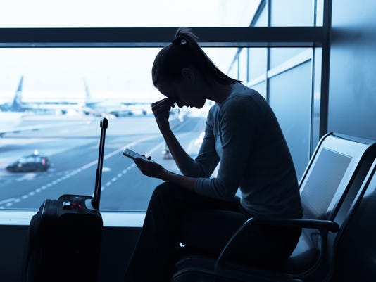 Stressed woman at the airport