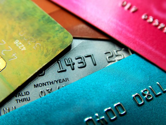 Stack of multicolored credit cards close-up view with