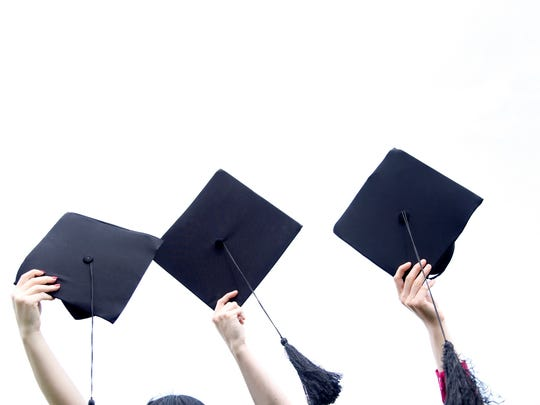 Holding graduation hats