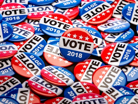 "FILE - ""Vote 2018"" pins."