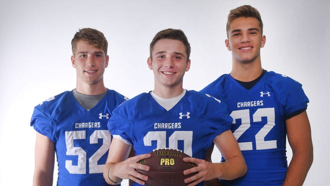 O'Gorman High School's Ryan Sjaarda, from left, Parker Nelson and Mitchell Goodbary during football media day Tuesday, Aug 7, at Argus Leader Media in Sioux Falls.