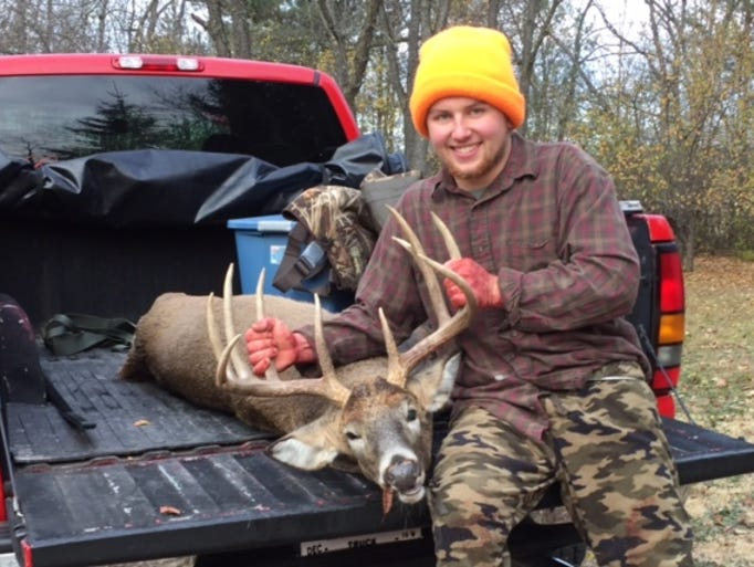 Bryce Dow of Burlington is seen with a 10-point buck