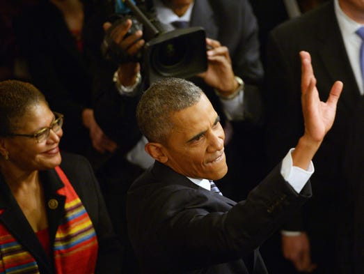President Obama gives a wave as he departs the House
