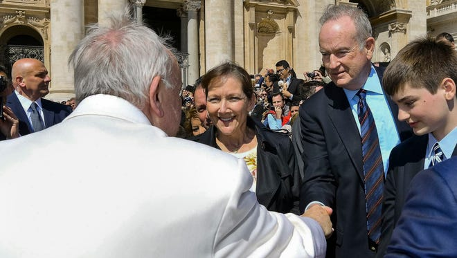 Pope Francis shakes hands with TV host Bill O'Reilly, second from right, during his weekly general audience, at the Vatican, Wednesday, April 19, 2017. O'Reilly is on a two-week vacation that on Wednesday took him to Francis' general audience in St. Peter's Square.