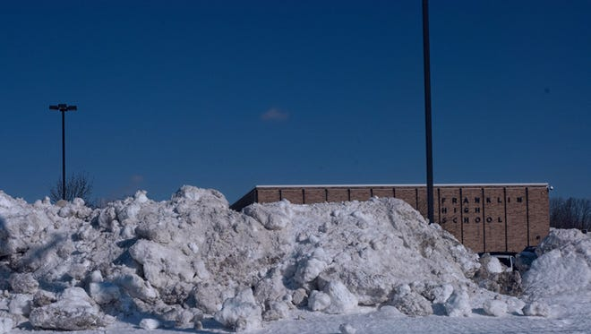 The heavy snows of the winter of 2013-14 were piled high at Franklin High School, Livonia.