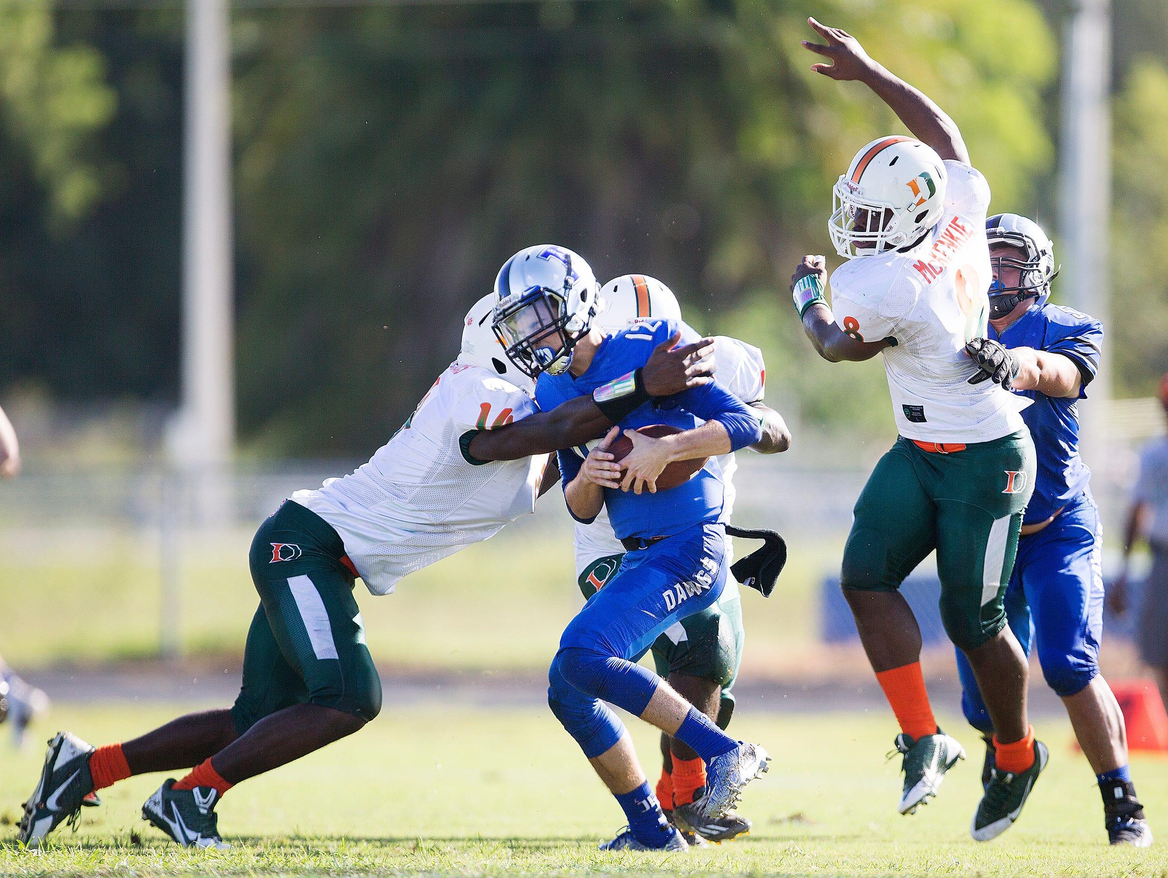 Dunbar High School's Rocky Jacques-louis sacks Ida Baker High School's Toby Noland during first quarter play Saturday at Ida Baker High School in Cape Coral.