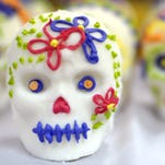 By Jamie Lynn Chevillet/Journal & Courier-- Decorated sugar skulls dry on a table at a celebration of the Day of the Dead hosted by Purdue University's Latino Cultural Center at the YWCA of Greater Lafayette  on Friday, October 30, 2009.