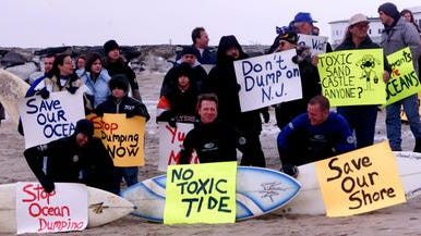 Opponents of dredged material dumping in the ocean protest in Sea Bright on Jan. 23, 2000 (Michael Goldfinger/Staff Photographer)