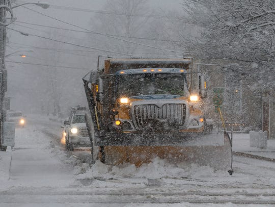 A snow plow goes to work on Bay Ave in Barnegat as