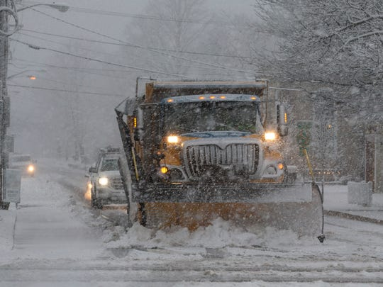 A snow plow goes to work on Bay Ave in Barnegat as the snow finally picks up intensity.