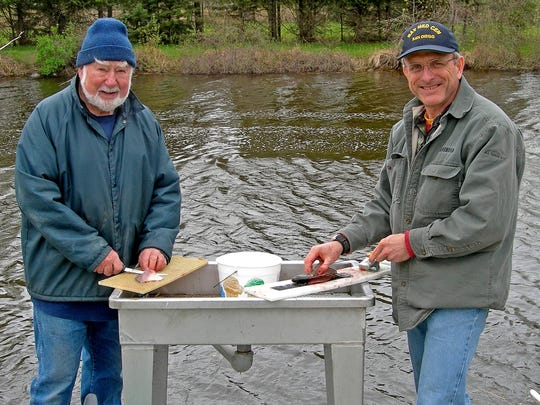 Ed Durkin, left, and his son Patrick often filleted fish caught by their family members.