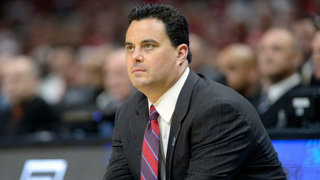 Arizona Wildcats head coach Sean Miller watches game action against Wisconsin Badgers during the first half in the finals of the west regional of the 2015 NCAA Tournament at Staples Center.