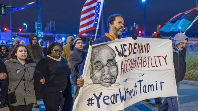 Demonstrators march Dec. 29, 2015, on Ontario Street in Cleveland to protest a grand jury's failure to indict Cleveland Police officer Timothy Loehmann for the fatal shooting of Tamir Rice on Nov. 22, 2014.